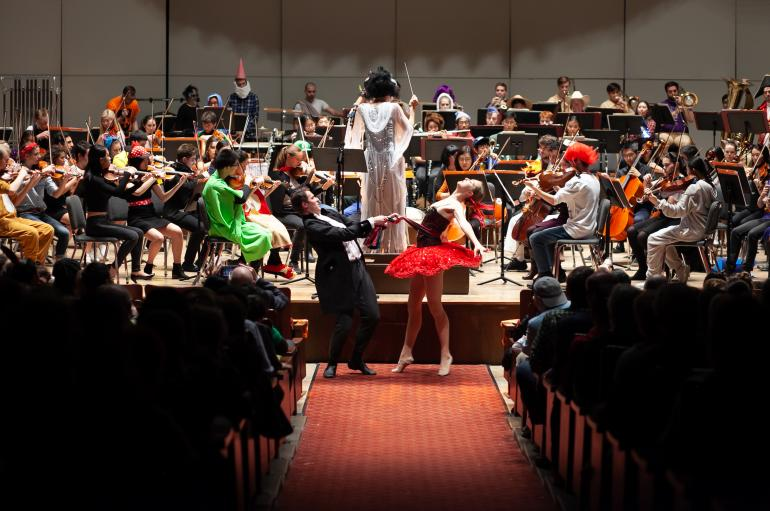 The University Symphony Orchestra performs in costume with Maestra Barbara Schubert and students from the Hyde Park School of Dance