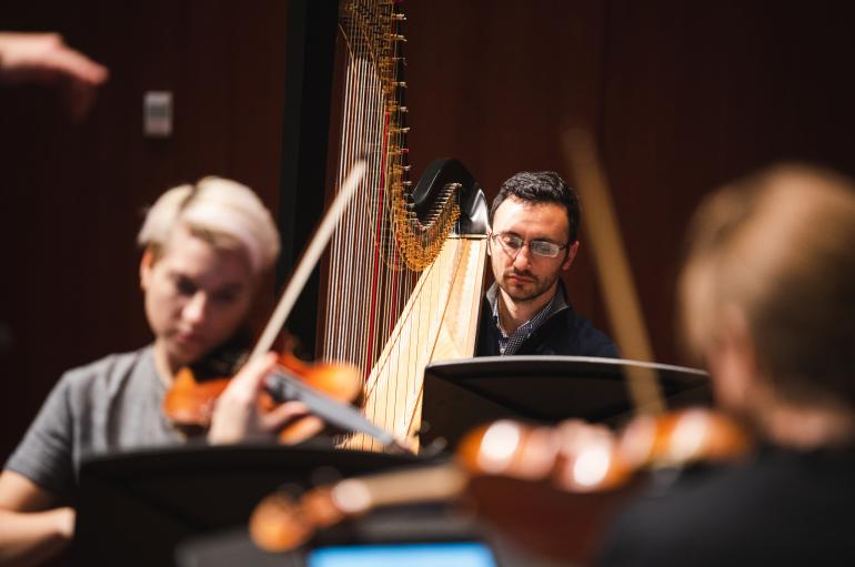 Violinist Maeve Feinberg and harpist Ben Melsky in rehearsal for the Grossman Ensemble