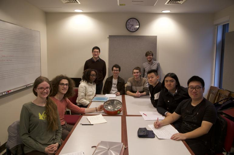 Anthony Cheung's advanced composition class seated around a conference table