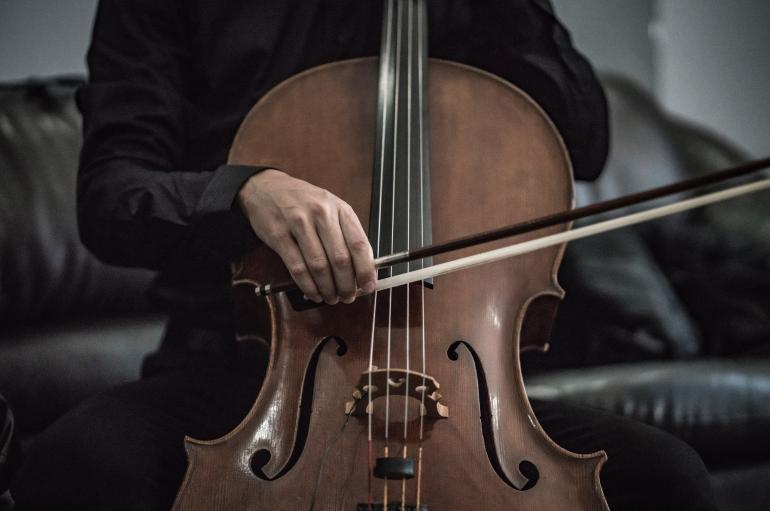 A man playing cello
