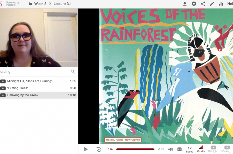 """Screenshot from Ailsa Lipscombe in a Panopto recorded lecture showing her face on the top left next to an image of album art that says """"Voices of the Rainforest"""""""