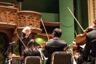 Barbara Schubert conducts the University Symphony Orchestra