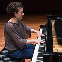 Clare Longendyke performing at the piano