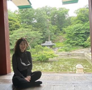 Tricia Park in front of a pond in Korea