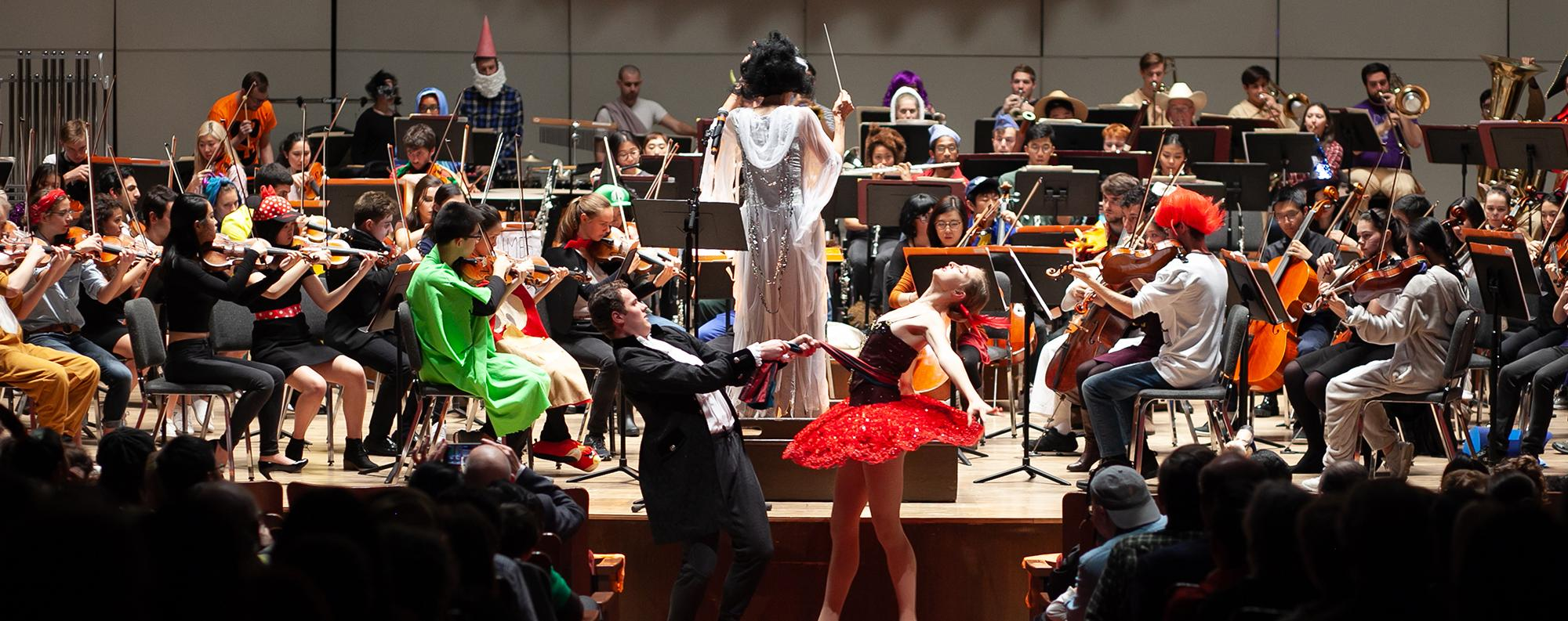Photo of the University Symphony Orchestra and dancers from the Hyde Park School of Dance performing in costume