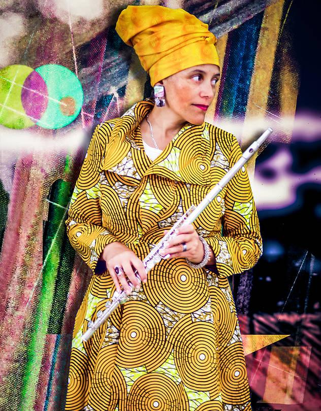 Nicole Mitchell, which a bright yellow headscarf and yellow patterned dress, holds a flute