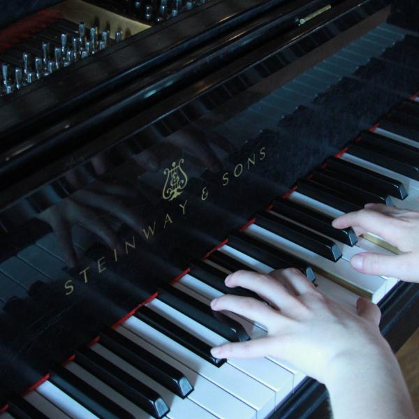 close-up of hands on a piano keyboard