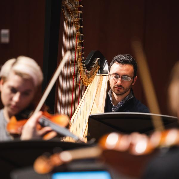 Violinist Maeve Feinberg and harpist Ben Melsky in rehearsal for the Grossman Ensemble