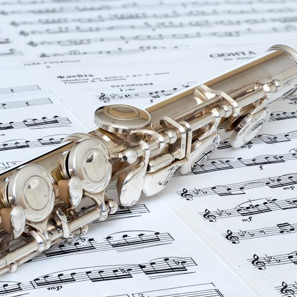 Flute sitting on sheet music