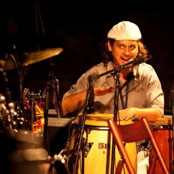 Afro-Cuban Folkloric Ensemble director Jean Leroy playing hand drums