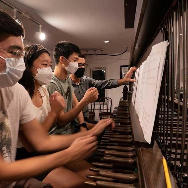 Fourth-years João Francisco Shida, Emily Kim and Joseph Min practice for the inauguration with University Carillonneur Joey Brink on the carillon in the bell tower of Rockefeller Memorial Chapel.
